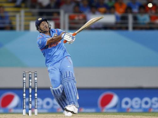 India's Dhoni hits a six during their Cricket World Cup match against Zimbabwe at Eden Park in Auckland