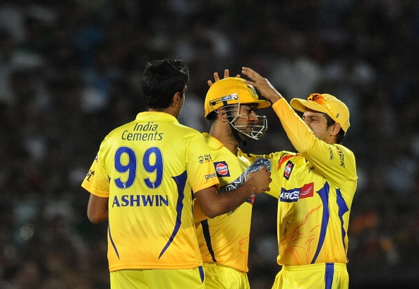RESTRICTED TO EDITORIAL USE. MOBILE USE WITHIN NEWS PACKAGE Chennai Super Kings bowler Ravichandran Ashwin (L) celebrates the wicket of Rajasthan Royals batsman Ashok Maneria with captain Mahendra Singh Dhoni (C) andSuresh Raina during the IPL Twenty20 match between Rajasthan Royals and Chennai Super Kings at the Swai Mansingh Stadium in Jaipur on May 9, 2011. AFP PHOTO / Prakash SINGH (Photo credit should read PRAKASH SINGH/AFP/Getty Images)