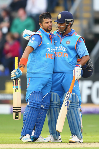 CARDIFF, WALES - AUGUST 27: Suresh Raina (L) of India is congratulated by capatin MS Dhoni (R) after reaching his century during the second Royal London One-Day Series match between England and India at the SWALEC Stadium on August 27, 2014 in Cardiff, Wales. (Photo by Michael Steele/Getty Images)