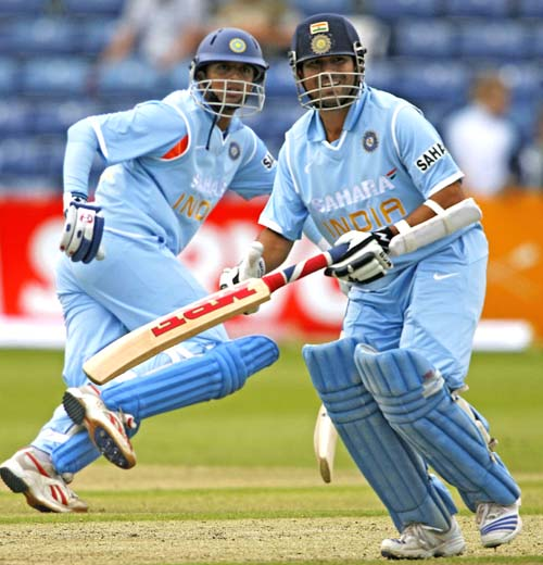 BELFAST, UNITED KINGDOM: Indian cricketers Rahul Dravid (L) and Sachin Tendulkar run between the wickets as they bat against South Africa during a One Day International match at Stormont cricket grounds in Belfast, Northern Ireland, 26 June 2007. AFP PHOTO/Peter MUHLY (Photo credit should read PETER MUHLY/AFP/Getty Images)