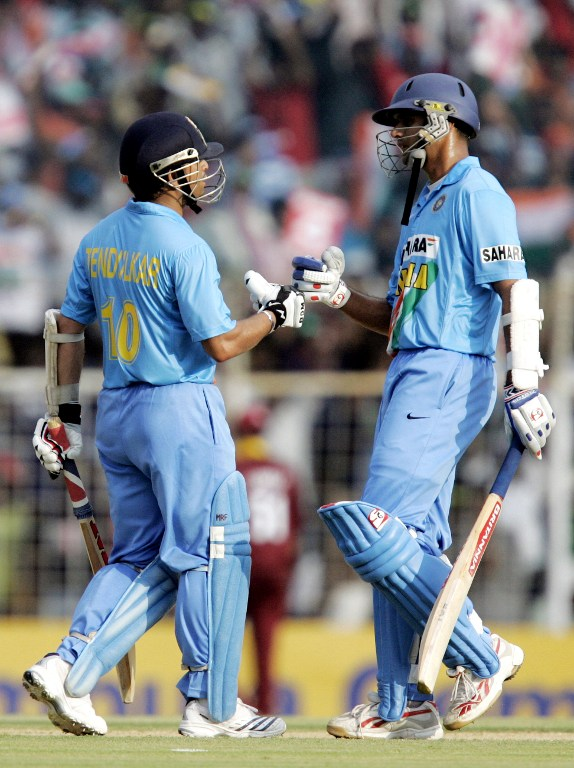 Indian cricket captain Rahul Dravid (R) congratulates team mate Sachin Tendulkar (L) upon his half century (50 Runs) during the third One Day International (ODI) match between India and the West Indies at the Chidambaram Stadium in Chennai, 27 January 2007. India were all out for 268 runs in 48 overs after West Indies won the toss and elected to field first. AFP PHOTO/Dibyangshu SARKAR