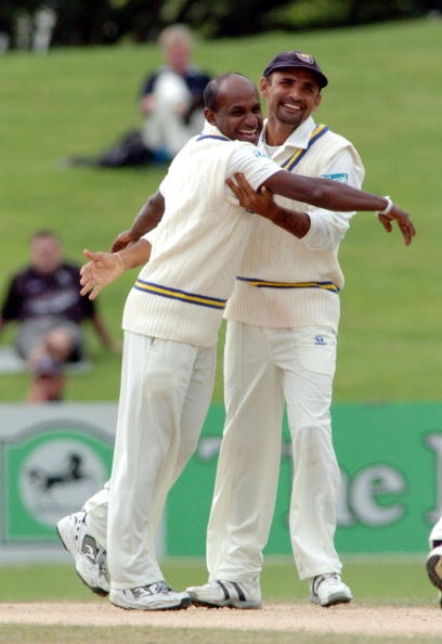 NEW ZEALAND - APRIL 08: Sri Lanka's Sanath Jayasuriya, left is hugged by his captain Marvan Atapattu after dismissing New Zealand's James Marshall lbw for 39 on the fifth day in the first cricket test at McLean Park Napier, New Zealand, Friday, April 08, 2005. (Photo by Ross Setford/Getty Images)