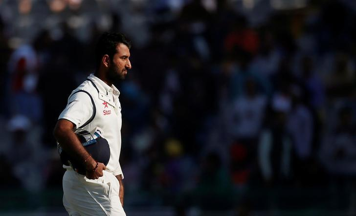 Cricket - India v England - Third Test cricket match - Punjab Cricket Association Stadium, Mohali, India - 27/11/16. India's Cheteshwar Pujara walks off the field after being dismissed. REUTERS/Adnan Abidi