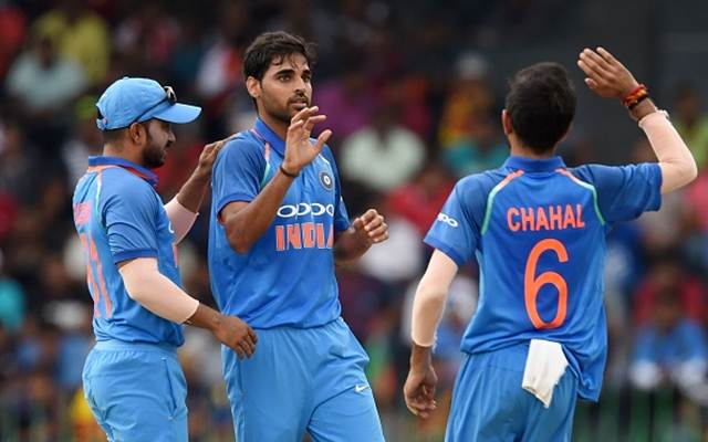 Indian cricketer Bhuvneshwar Kumar (C) celebrates with his teammates after he dismissed Sri Lankan cricketer Niroshan Dickwella during the final one day international (ODI) cricket match between Sri Lanka and India at R. Premadasa Stadium in Colombo on September 3, 2017. / AFP PHOTO / ISHARA S. KODIKARA        (Photo credit should read ISHARA S. KODIKARA/AFP/Getty Images)