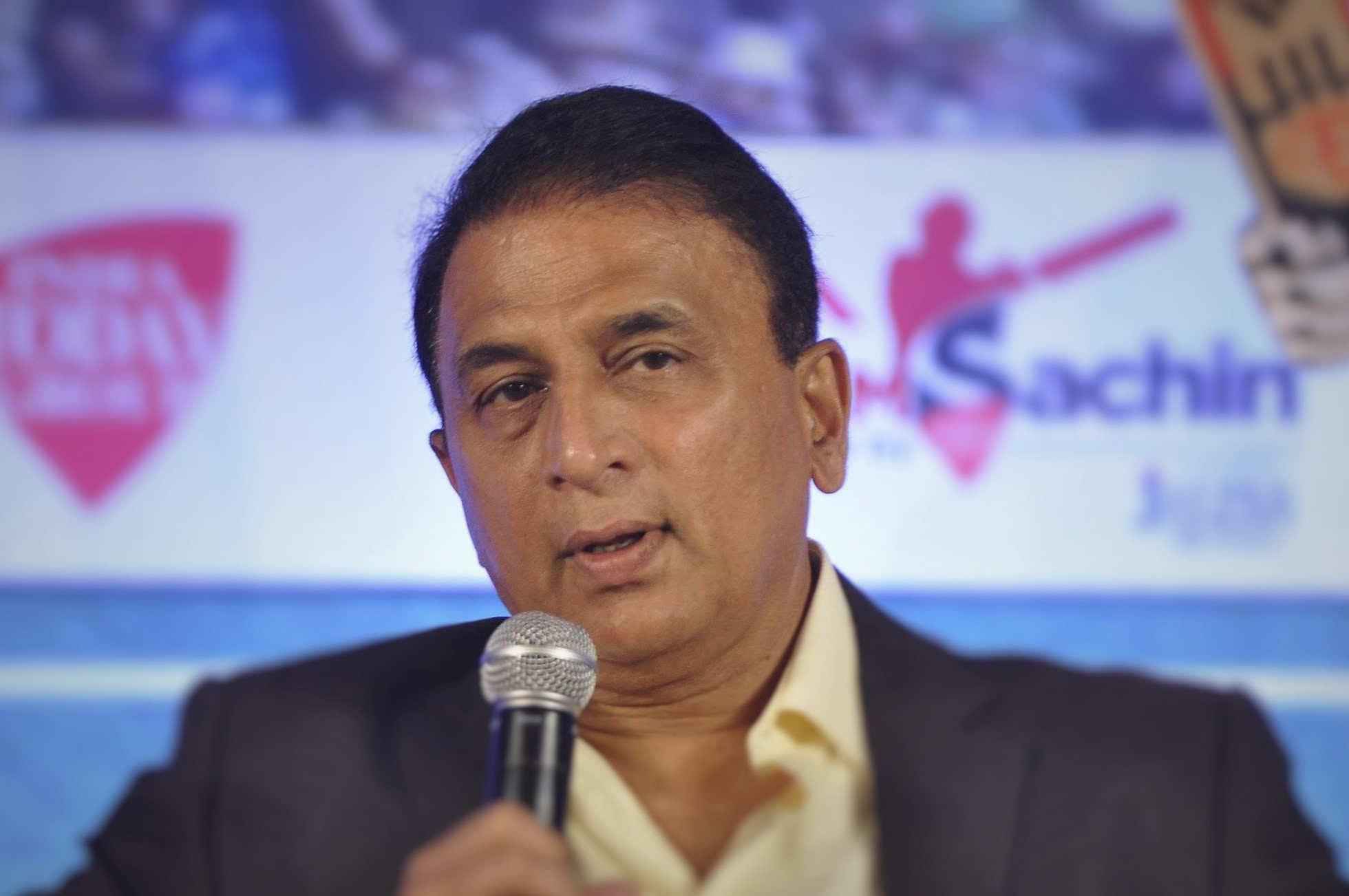 Former Indian cricketer Sunil Gavaskar during the Salute Sachin marathon broadcast by Aaj Tak Nehru Center in Mumbai on November 12, 2013. (Photo: IANS)