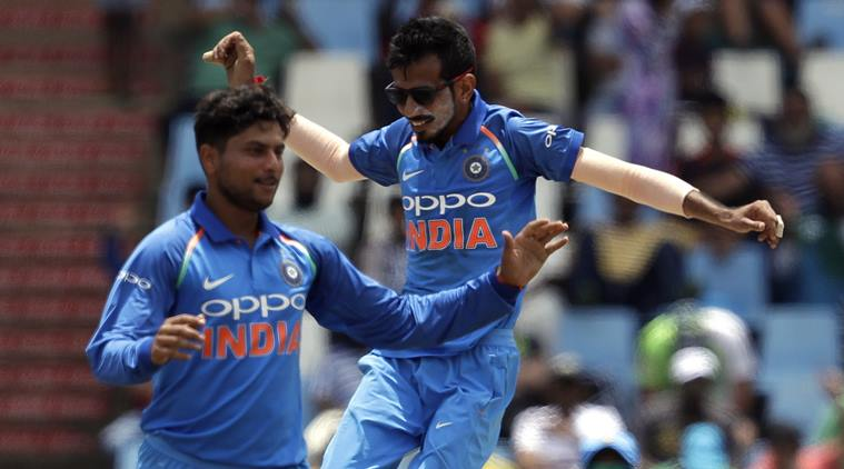 India's bowler Kuldeep Yadav, left, celebrates with teammate Yuzvendra Chahal after taking a third wicket of South Africa's batsman Kagiso Rabada, during the second One Day International cricket match between South Africa and India at Centurion Park in Pretoria, South Africa, Sunday, Feb. 4, 2018. (AP Photo/Themba Hadebe)