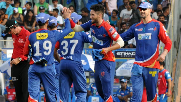 Delhi-Daredevils-players-celebrate-fall-of-a-wicket-during-51st-match-of-IPL-2014-between-Mumbai-Indians-2