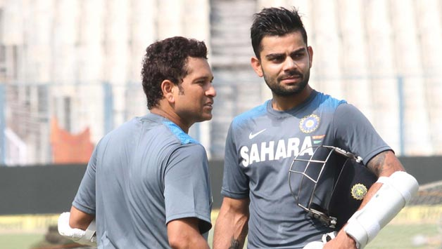 Indian-Cricketers-Sachin-Tendulkar-and-Virat-Kohli-during-a-practice-session-ahead-of-test-match-between-India-and-West-Indies-2