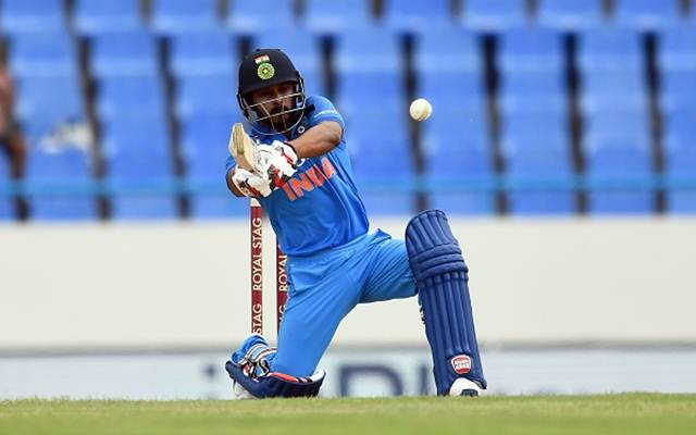 India's Kedar Jadhav hits a boundary during the third One Day International (ODI) match between West Indies and India, at the Sir Vivian Richards Cricket Ground in St. John's, Antigua, on June 30, 2107. India have scored 251/4 at the end of their innings. / AFP PHOTO / Jewel SAMAD (Photo credit should read JEWEL SAMAD/AFP/Getty Images)