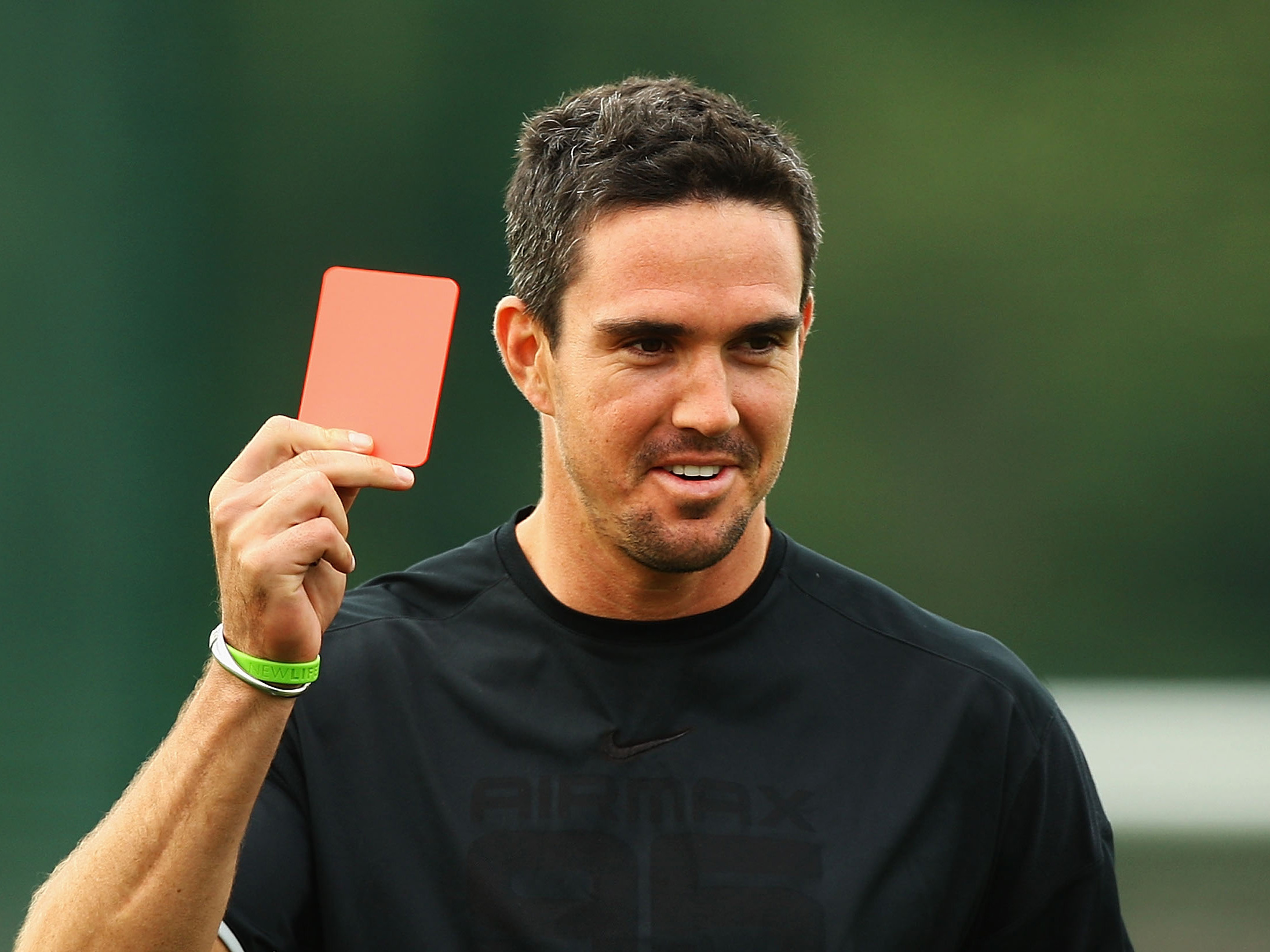 NOTTINGHAM, ENGLAND - JUNE 09: Kevin Pietersen of England produces a red card during a game of football at Gresham Sports Park on June 9, 2009 in Nottingham, England. (Photo by Matthew Lewis/Getty Images)