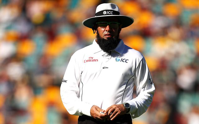 BRISBANE, AUSTRALIA - NOVEMBER 23: Umpire Aleem Dar walks to pick up the bail during day one of the First Test Match of the 2017/18 Ashes Series between Australia and England at The Gabba on November 23, 2017 in Brisbane, Australia.  (Photo by Mark Kolbe/Getty Images)