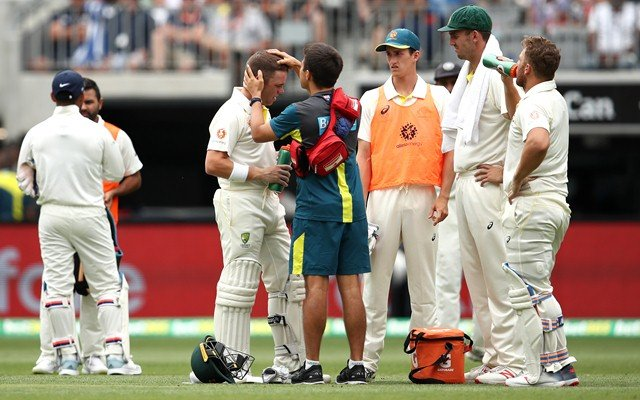 PERTH, AUSTRALIA - DECEMBER 16: Marcus Harris of Australia receives attention after being struck by the ball during day three of the second match in the Test series between Australia and India at Perth Stadium on December 16, 2018 in Perth, Australia. (Photo by Cameron Spencer/Getty Images)