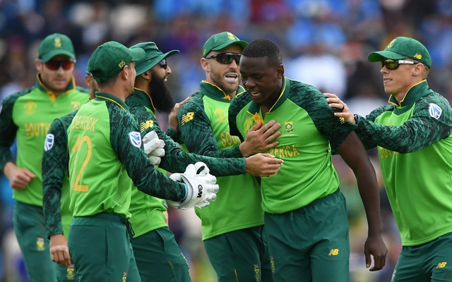 SOUTHAMPTON, ENGLAND - JUNE 05: Kagiso Rabada of South Africa celebrates the wicket of Shikhar Dhawan of India with his teammates during the Group Stage match of the ICC Cricket World Cup 2019 between South Africa and India at The Hampshire Bowl on June 05, 2019 in Southampton, England. (Photo by Alex Davidson/Getty Images)