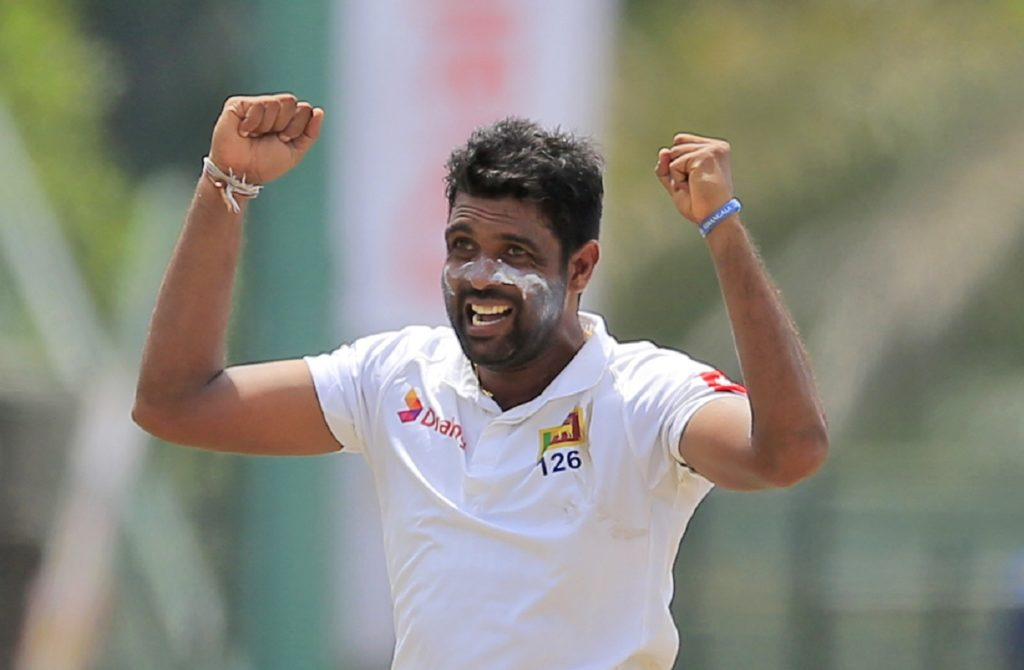 Sri Lanka's Dilruwan Perera celebrates taking the wicket of South Africa's Faf du Plessis during the second day of their second test cricket match in Colombo, Sri Lanka, Saturday, July 21, 2018. (AP Photo/Eranga Jayawardena)