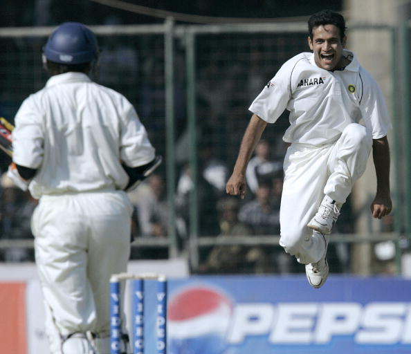 New Delhi, INDIA: India's Irfan Pathan (R) jubliates after dissmissing Sri Lankan Kumara Sangakkara (L) for 3 during the second day of the second Test against Sri Lanka at the Ferozeshah Kotla ground in New Delhi, 11 December 2005. Sri Lanka were 198-6 in their first innings at stumps in reply to India's 290. AFP PHOTO/Prakash SINGH (Photo credit should read PRAKASH SINGH/AFP via Getty Images)